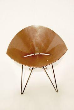 Roman Modzelewski's plywood armchair now reintroduced by Vzor under RM56 wood name.