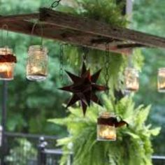 traditional patio Hanging Ladder Lantern Chandelier for the Patio - old ladder & mason jars repurposed Old Ladder, Vintage Ladder, Rustic Ladder, Antique Ladder, Small Ladder, Bottles And Jars, Mason Jars, Canning Jars, Glass Jars