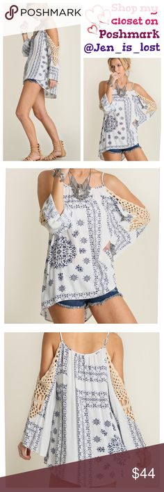 Never Too Cold Shoulder TunicM Never Too Cold Shoulder Tunic /w PrintThis is a cold shoulder people won't mind getting, keep it hot and chic with this hotlist top. Fabric: COTTON BLEND  Woman's size Small (2-4) Medium (6-8) Large (10-12). True to size. 🚫No Trades🚫 ✅Reasonable Offers Are Considered✅ Use the blue offer button. Tops Tunics