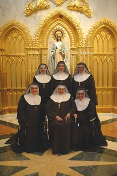 A Franciscan Community of Poor Clare Nuns of Perpetual Adoration. Sr Angelica in the centre. Front row.