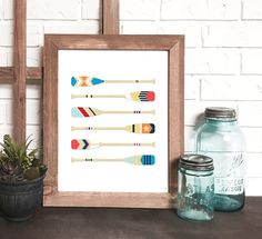 Nautical painted boat paddle print by devon design co on etsy #nauticalart #paintedpaddles #paintedoars #nauticaldecor #coastaldecor #beachart #cabinart