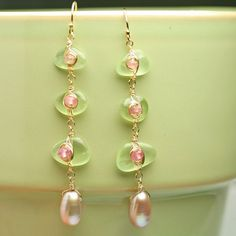 Dotted Prehnite Pebble Earrings Long Dangle by fussjewelry on Etsy, $112.00Smooth pebbles of spring green prehnite are wrapped with gold fill wire and dotted with faceted pink tourmaline. At the bottom dangles a pink freshwater drop pearl. These earrings measure about 2 3/4 inches long.