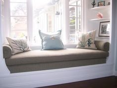 I know it's just an ad for upholstering - but this window seat is amazing :) must have