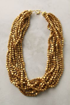 This multi-strand gold necklace really packs a punch! #wedding #bling