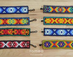 LARGE Huichol beaded bracelets. These bracelets are made for large wrists! Huichol Art Made in Mexico Qty Available: ONLY 1 OF EACH - Size: A: L 8 inch W 2 inch B: L 8.25 inch W 2inch C: L 7.75 inch W 2 inch D: L 8.25 inch W 1.75 inch E: L 8.25 inch W 2 inch Visit our store to see our lines of vintage and handmade products: www.etsy.com/shop/RomeaAccessories Please read and understand our return policy. Let us know if you have any questions Thanks for visiting us