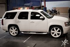Google Image Result for http://pics.celebritycarsblog.com/wp-content/uploads/2011/04/Rob-Dyrdek-Cars-Matte-White-Chevy-Tahoe.jpg