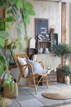 Recycled crates and a wicker chair give this patio a french country look - #DIY #Garden #Ideas