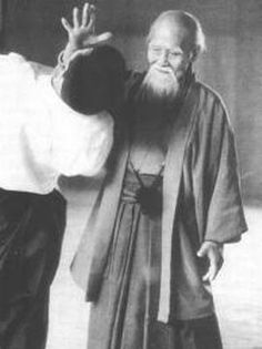 "Morihei Ueshiba (December 14, 1883 – April 26, 1969) creator of Aikido, a martial art to help practitioners defend themselves while also protecting their attacker from injury. Aikido is often translated as ""the Way of unifying (with) life energy"" or as ""the Way of harmonious spirit."" It works by blending motions of the attacker and redirecting the force of the attack (rather than opposing it), thus requiring very little physical strength."