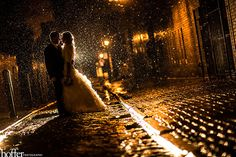 These are unbelievably gorgeous shots! The problem is, a: you have to have rain (unlikely here), b: to get really good under-the-downpour moments you almost certainly have to ruin your dress. But so beautiful!!