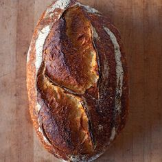 """Loaves made with a natural leaven keep for a week -- one reason Chad Robertson, of San Francisco's legendary Tartine Bakery, prefers this time-honored technique. The resulting bread boasts a thick, burnished crust and a moist interior shot through with holes. Get the step-by-step guide here. Recipe and image reprinted with permission from """"Tartine Bread,"""" by Chad Robertson, with photographs by Eric Wolfinger."""
