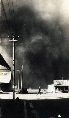Clouds of dust roll over the northwest Kansas town of Zurich in the 1930's.  The pictures are looking north across highway 18.   (photo courtesy of Marion Renner)