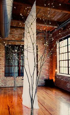 Minus the obvious alter this room would make a great yoga studio with the wood floors and exposed brick