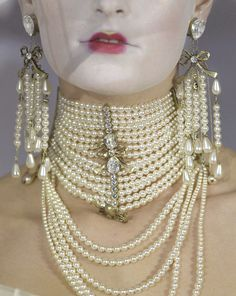 Christian Dior Haute Couture Spring 2007Jewelry details   ...as for the make up...why?