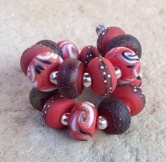 Etsy listing at https://www.etsy.com/listing/242497963/coral-rust-with-pure-silver-lampwork