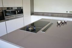 Grey kitchen island with pop up extractor and induction hob