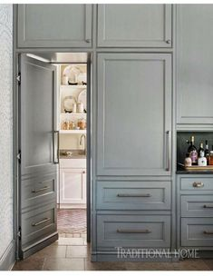 """Atlanta kitchen with a soaring ceiling To the left of the range, Jennifer's """"secret door"""" opens to reveal a secondary prep zone and storage spot. – Photo: Lisa Mowry / Design: Clay Snider - Own Kitchen Pantry Kitchen Pantry Design, Kitchen Pantry Cabinets, Kitchen Doors, Kitchen And Bath, Kitchen Storage, Prep Kitchen, Kitchen Ideas, Kitchen With Pantry, Kitchen Cabinet Door Styles"""