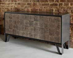 The metal sideboard is composed of panels cut from the end grain of an oak log.  Mixed media class...