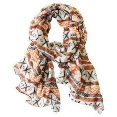 """Highlighted by a Southwestern-inspired motif, this chic scarf pairs with your favorite jeans and t-shirts or adds fresh touch to that little black dress.   Product: ScarfConstruction Material: 100% PolyesterColor: Orange, raw sienna, black and translucent yellowDimensions: 75"""" x 42"""""""