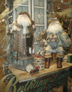 Use antique stained glass to add extra sparkle and elegance to your Christmas displays. Photo of original Santas from artist Bethany Lowe, at the Bethany Lowe Designs showroom in Atlanta. http://bethanylowe.com/