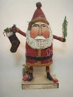 Hey, I found this really awesome Etsy listing at https://www.etsy.com/listing/129548872/primitive-paper-mache-folk-art-santa