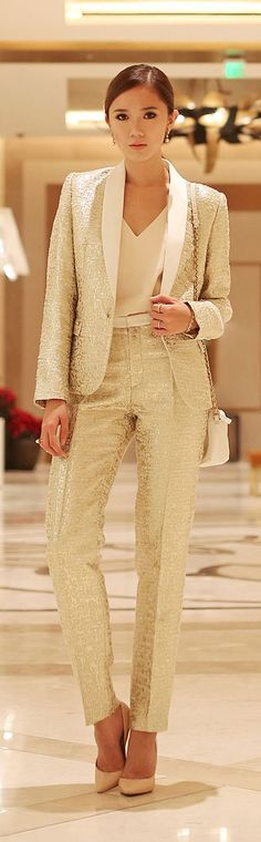 Camille Co wearing a stunning gold pant suit