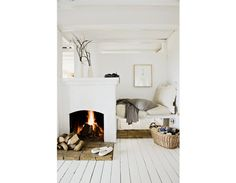 Cozy sleeping nook white washed floor neutral accessories