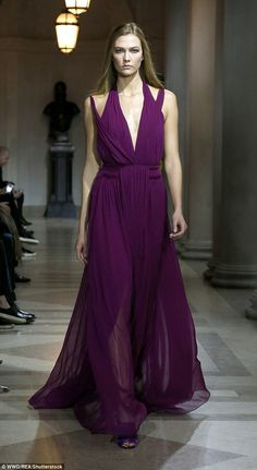 Back to work! Karlie Kloss sashays down catwalk wearing purple dress with plunging neckline for Carolina Herrera at NYFW | Daily Mail Online