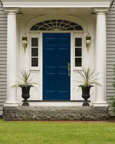 Traditional entrance with a French navy blue door
