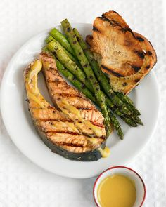 Serve grilled salmon steaks and asparagus with a sweet and tangy sauce made from Dijon mustard, sugar, and white-wine vinegar. Use leftover asparagus as a side dish for your next dinner; the vegetable will keep in the refrigerator for up to two days.