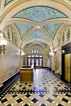 Monroe Building (1912, Holabird & Roche) has a brilliantly-colored lobby with a rhythmic vaulted ceiling that comprises one of the world's largest collections of Rookwood Pottery tile.