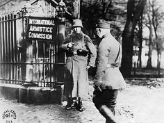 Spa, Belgium March 6, 1919. An unusual scene at the Armistice Commission grounds in Spa where an American officer is passing a German sentinel. The sentinel is there because German representatives are in the city arranging for carrying out the Armistice, and Spa had not yet been evacuated by the Germans.