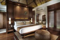 Resort like bedroom - detail with ceiling - like Samoan fale , floors, white and brown