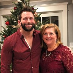 WWE Superstar Zack Ryder (Matthew Cardona) with his mother Terry Cardona in front of the family Christmas tree.