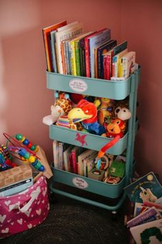 Organize books and stuffed animals this handy three-tiered piece. The best part? It's on wheels, so you can transport it to any section of the room.  See more at Project Nursery »