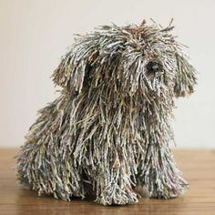 This little pup looks like he is made with twisted newspaper.