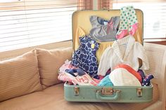 Could use an old suitcase to hold items for the game where you have to remember as many baby items that you saw in a short time. If there will be games...