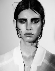 Wet look. I love how they've played up her angular features with strong contour.