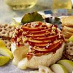 Plum and Walnut Baked Brie - Warm, melty brie alone is always an elegant appetizer to offer guests. A simple adornment of thinly sliced red plum glazed with preserves and garnished with chopped toasted walnuts is sure to please them even more. Easter Appetizers, Elegant Appetizers, Cheese Appetizers, Appetizer Recipes, Snack Recipes, Appetizer Ideas, Snacks, Baked Brie Recipes, Cheese Recipes