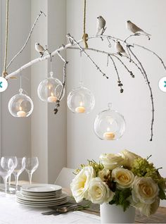 DIY centerpiece: branch with hanging tea lights