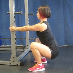Great stretch/warm up: Air squat using a rack for support
