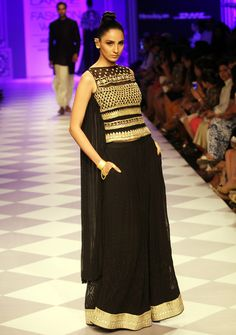 """Model walking on the ramp to showcase @anitadongre's """"India Modern"""" bridal collection on Day 4 at the Lakme Fashion Week Winter/Festive 2014. #Fashion #Style #Beauty"""