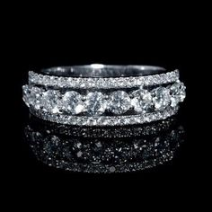 NEW: Three row diamond wedding ring featuring 54 round brilliant cut white diamonds 1.50ctw set in 18k white gold. #love #bridal #jewelry