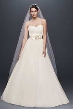 You won't be able to imagine going down the aisle in any other wedding dress once you try on this stunning strapless tulle ball gown. Not only do you get the sweetheart neckline you wanted but the beautifully pleated bodice is sure to please. Complete your look by embellishing your waist with a dazzling sash!   David's Bridal Collection.  Also available in Regular, Plus Size, Extra Length, Plus Size Extra Length, Plus Size No Train, Plus Size Extra Length No Train and Extra Length No Train.