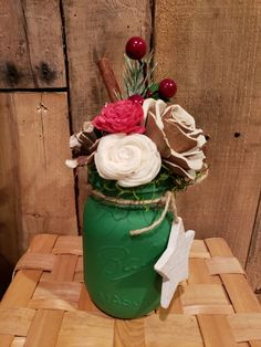 Christmas mason jar, filled with wood flower, cinnamon, greenery ,green and pic. Shabby chic, rusty, farmhouse.  Perfect for the holidays.