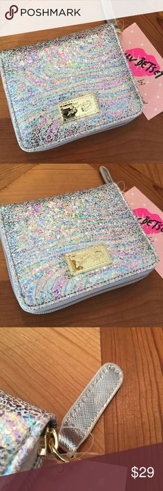 Betsey Johnson Metallic Textured Zip Wallet Betsey Johnson Zip Around Wallet Metallic Iridescent Texture Zipper Pull has a small scratch. (pictured) Please feel free to make an offer. Betsey Johnson Bags Wallets