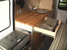 Sprinter-Van-Camper-RV-Conversion-Package-Toy-Hauler; that's the way to do it - hide the burner and fridge in drawers!
