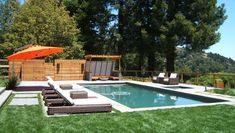 Gorgeous Pool Supply Unlimited convention San Francisco Modern Pool Image Ideas with concrete pavers horizontal wood panels lawn lounge chairs orange umbrella storage white wicker wood