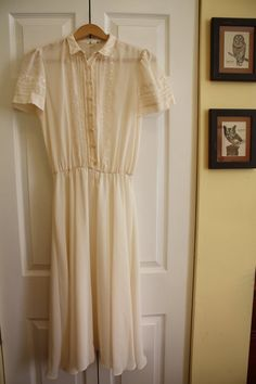 Vintage White/Cream Semi-Sheer Dress with Collar and Embroidered Accents  via Etsy.