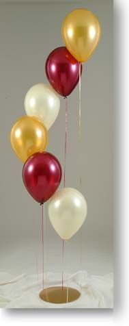 Gradated lengths of ribbon display balloons in school colors for your graduation party.