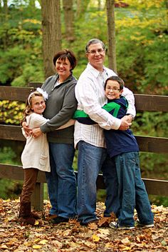 Family pose--parents back to back. Cute, but I'd do a father/daughter and mother/son pose to create more contrast.